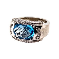Modern Gold 5.43 Carat Natural Oval Blue Topaz & Colorless Diamond Cocktail Ring