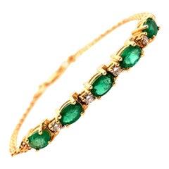 Modern Gold Bracelet 2.50 Carat Natural Oval Emerald and Diamond Gem, circa 1980