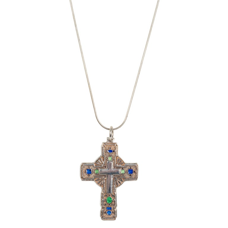 Of contemporary design in polished and matte silver, the front enameled with translucent green and blue enamel reserves enclosing a polished silver cross, attached to contemporary chain.  Excellent condition  2 in. (5.1 cm) long including suspension