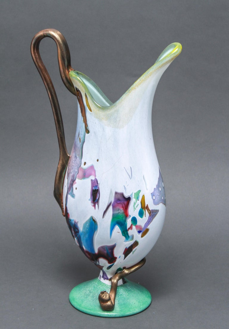 Modern hand blown glass pitcher or decorative ewer with an applied handle and a multicolored decorative motif. The piece was likely made during the late 20th century. In great vintage condition with age-appropriate wear.
