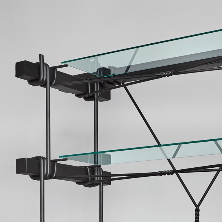 Hand forged cabinet with shelves designed with massive steel and glass top. Two Dutch designers, with different backgrounds yet with the same binding techniques, came together to create this Industrial-looking cabinet with shelves. While Tessa Koot