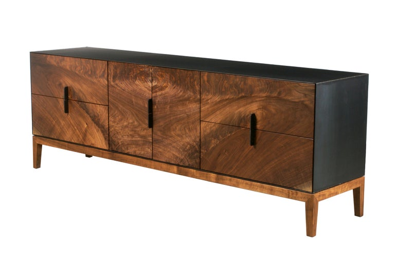 Bookmatched pieces of highly figured solid walnut make up the front of the limited edition taper series media cabinet. Center doors open to reveal electronics storage, complete with cable management, while two pairs of drawers store media on either