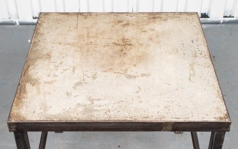 """Modern iron and cast stone side table. Measures: 24"""" H x 24"""" W x 24"""" D."""