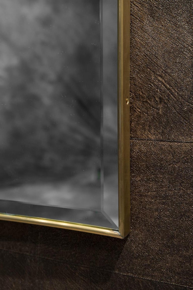 Elegant mirror designed in the style of Gio Ponti from the 1940s-1950s. A lean, tapered design, original silvered mirror in wonderful conditionenhanced by a charming patina on the brass.