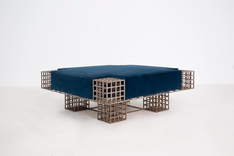 Sculptural square center bench designed by the famous Italian gallerist and publisher Carla Sozzani. The bench is from 1970. Its metal structure made with modular design creates a perfect symmetry with the module and sculpture. The bench seems to