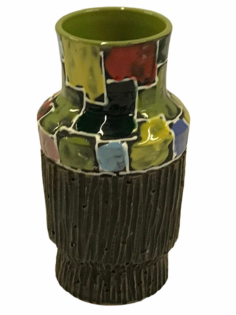 Organic Mid-Century Modern textured Italian Pottery cylindrical vase attributed to Alvino Bagni in a Mosaic design. Made by Fratelli Fanciullacci in the early 1960s. With glossy glazed squares in yellow, pink, orange, red, green and shades of blues