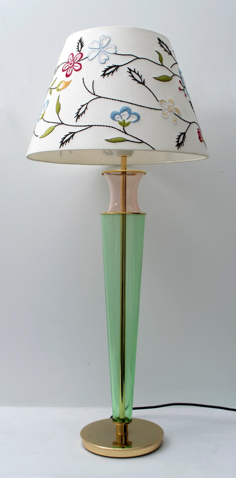 This lamp was created by Maestri Muranesi, with the blown glass technique, in green and pink colors, the supports are in brass, Italy, 1980s.