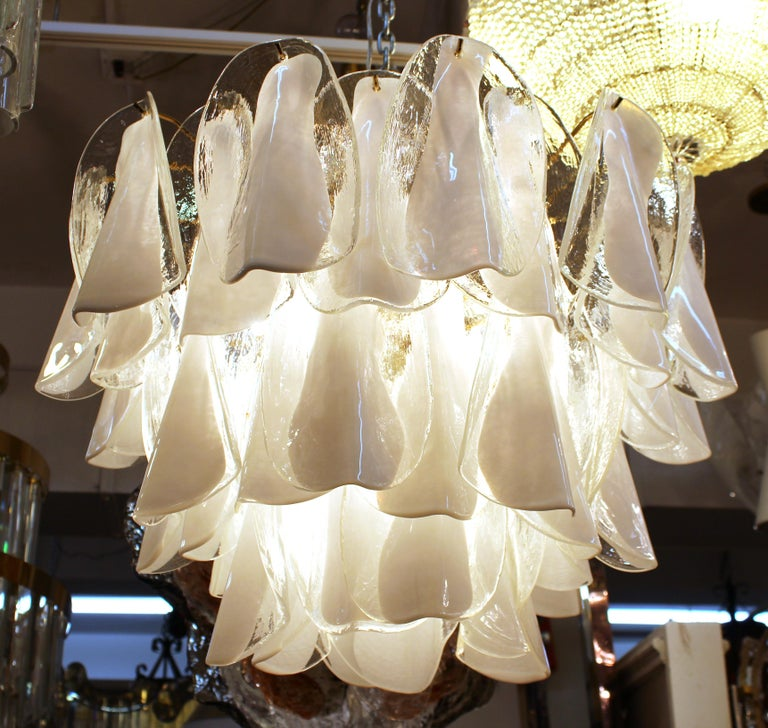 Modern Italian Murano glass chandelier with three tiers of semi-folded glass leaflets in white and clear glass. The piece is great vintage condition and has recently been rewired.