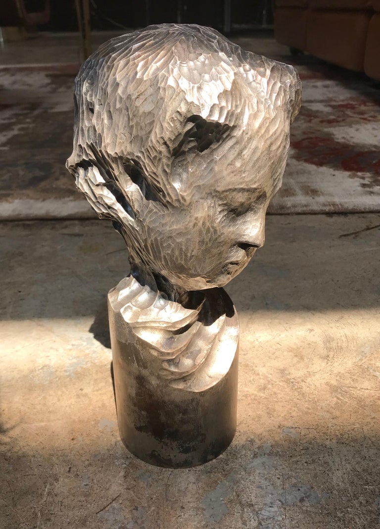 An exceptional, fine and impressive Italian sculpture sterling silver child portrait, 1970s.
