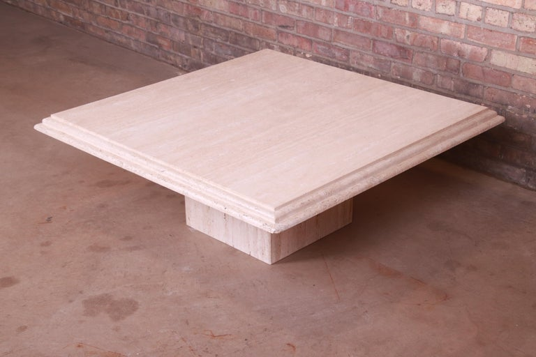 A gorgeous modern Italian travertine marble coffee or cocktail table  By Stone International  Italy, Circa 1970s  Measures: 42