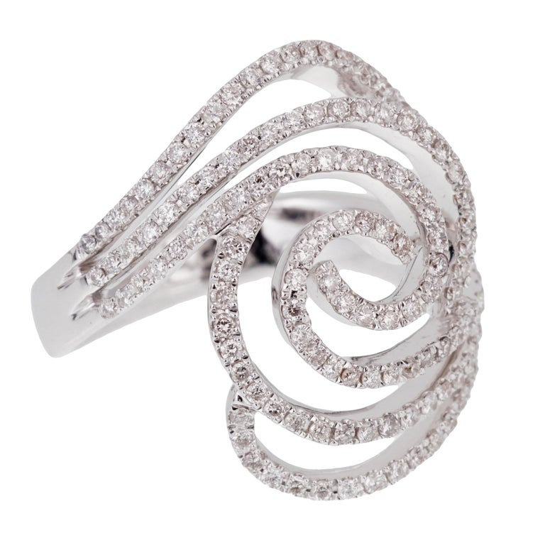 A fabulous ladies diamond cocktail ring featuring a circular pattern adorned with round brilliant cut diamonds in 18k white gold.  The ring measures a size 6 1/2 and can be resized