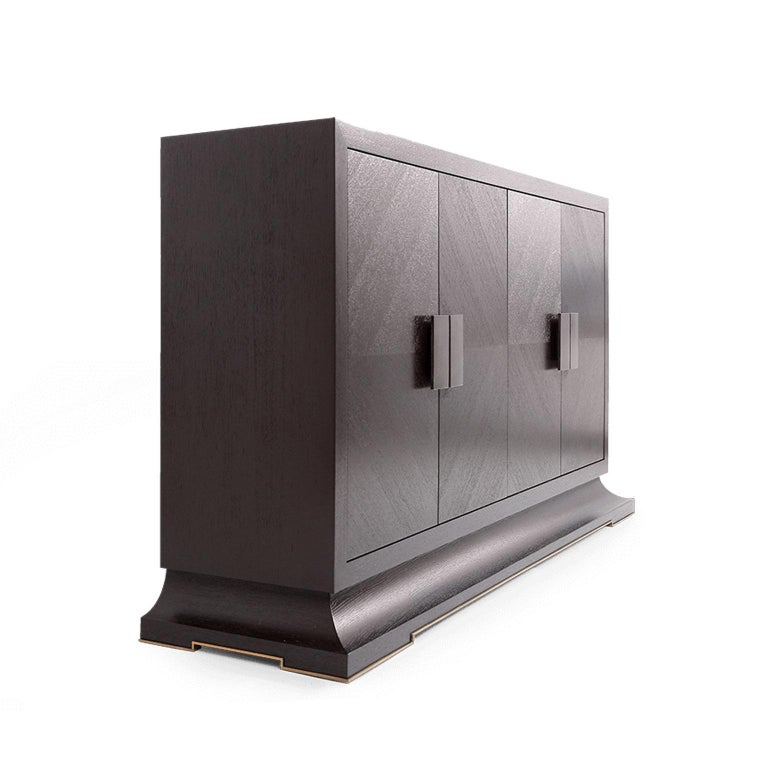 A beautiful sideboard with oakwood inlaying doors, and stunning aged brass handles. The oakwood inlaying is made in a special marquetry technique and finished with 2 coats of anti scratch rich dark brown paint. Combining luxury design with brilliant