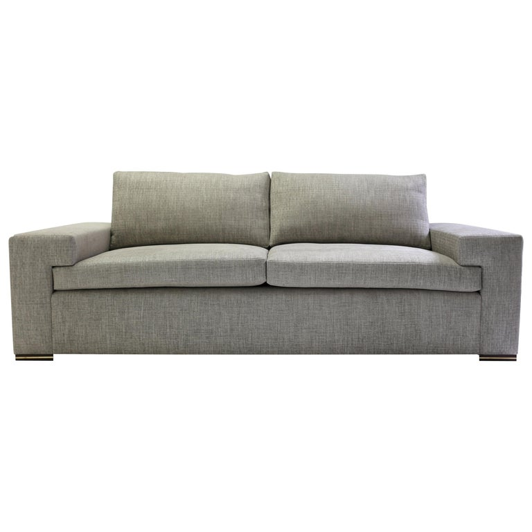 Modern Large Sofa with Large Pull Out Table and Metal Details on Wood Legs For Sale