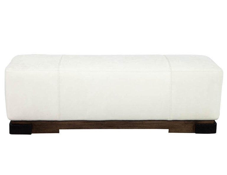 Modern leather ottoman by Kara Mann. Classic modern style with a walnut base designed by Kara Mann for Baker Milling Road. Price includes complimentary curb side delivery to the continental USA.