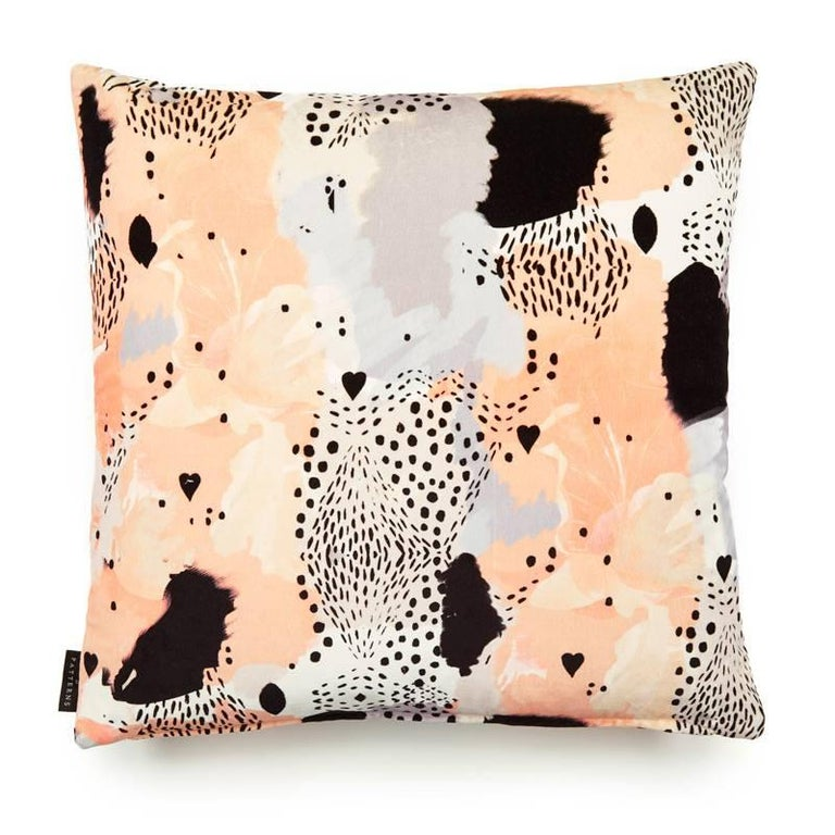 Love leopard peach cotton velvet cushion by 17 Patterns (London, UK) a beautiful exploration into the wild. Using traditional and digital mark-making techniques, this alluring composition of love hearts, spot formations and peppered textured