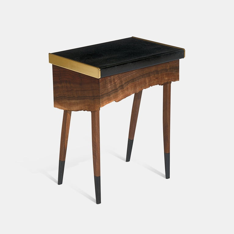 One of a kind, customizable side table from Jessie Nelson Studio. Each table is unique to the live edge sourced. Table is made of a single piece of live edge claro walnut, crafted to make the sides and face of the drawer. The wood grain wraps