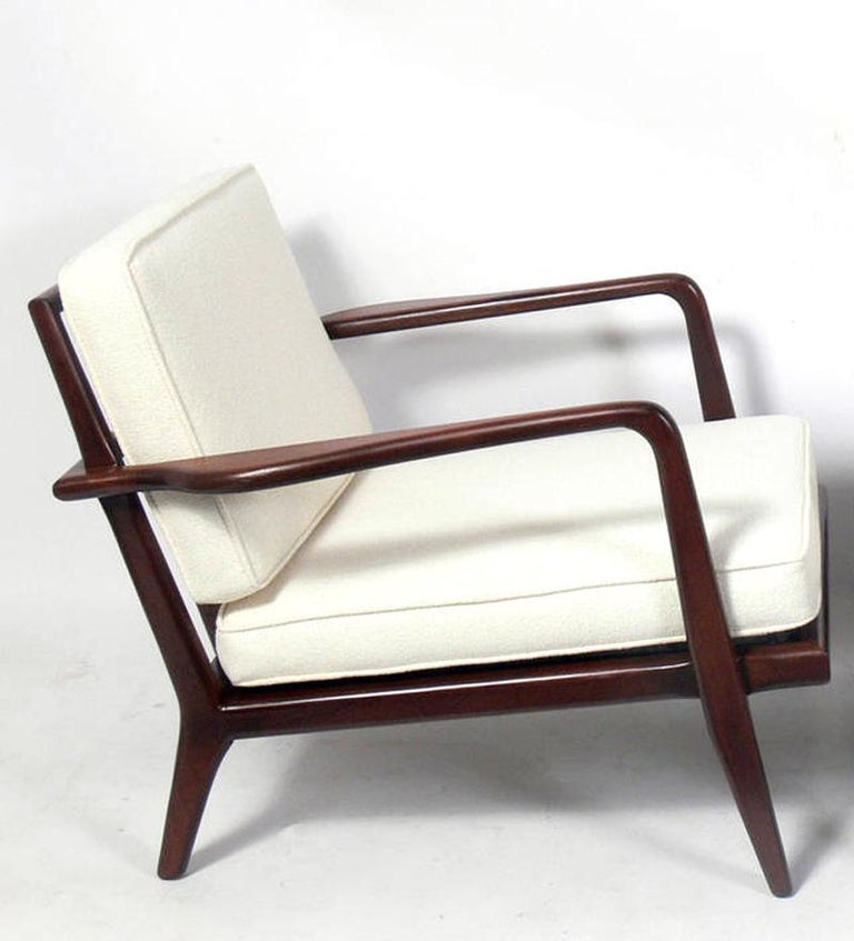 Danish modern style walnut lounge chair designed by Mel Smilow for his company Smilow-Thielle, American, circa 1950s. Signed under the seat. It has been refinished and reupholstered in an ivory color herringbone fabric.