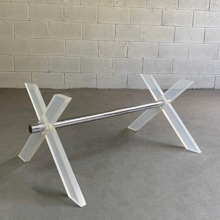 Slick, 1970s modern, coffee table base features two, 1 inch thick, Lucite X-forms connected by a 1.5 inch chrome rod. The base can accept the size and shape top of your choice.