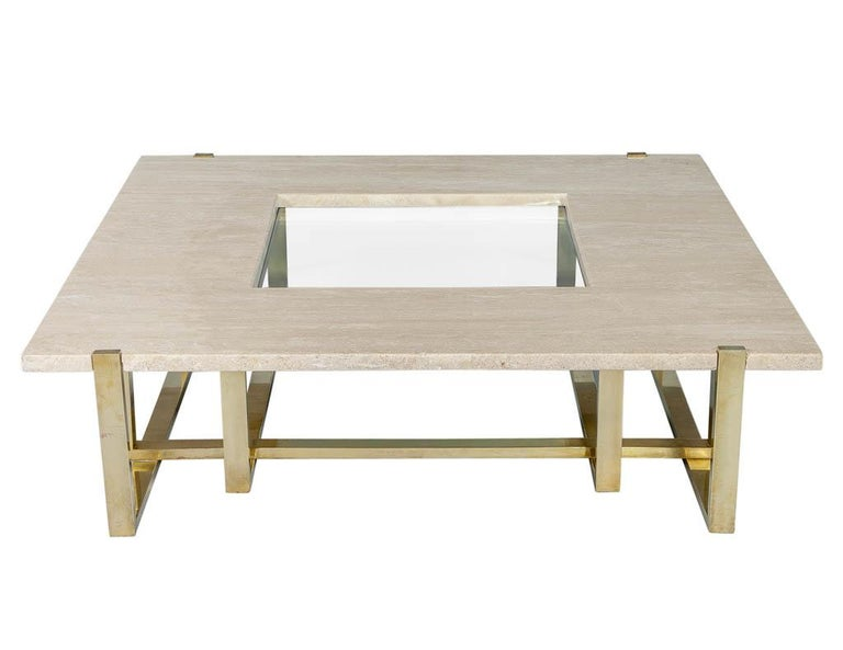 Created for the infamous Maison Jansen by Alfredo Freda, this stunning table will ignite any setting it is placed in. With a rich combination of edgy polished brass, travertine top with a central glass inset, this table epitomizes effortless elegant