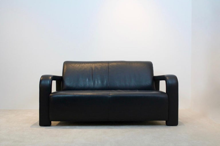 Amazing black leather two seat sofa manufactured by Marinelli of Italy. This sofa is very solid and extremely comfortable to sit in. The sofa has a very solid frame and original upholstery in beautiful leather, signed