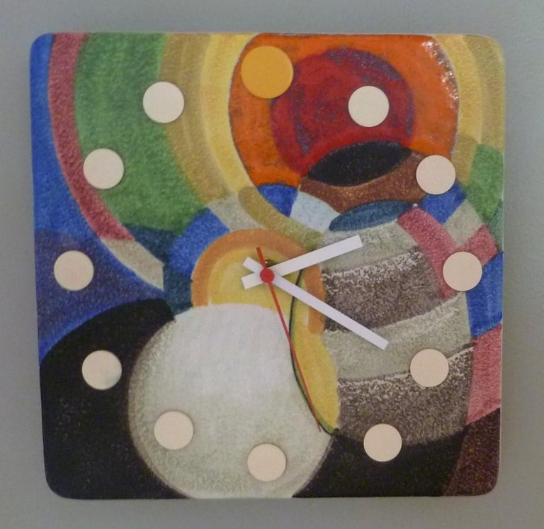 A rarely seen Mid-Century Modern Italian ceramic wall clock from the Howard Miller Meridian collection. This particular colorful abstract design clock was made towards the end of the Meridian clocks production, which ended in 1974. It features a