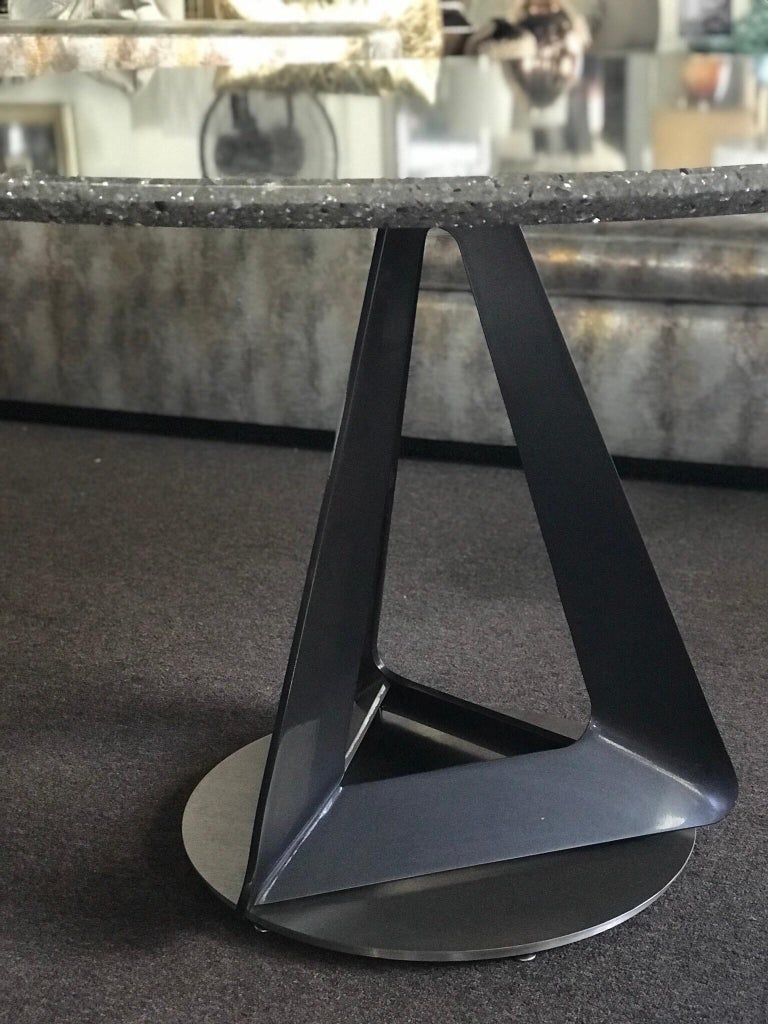 This Beauty came from one of the most expensive, upscale country clubs in the Palm Springs area. I don't know much about it, other than it is a modern sculpture in the form of a dining or game table. It was custom made for the residence. I am pretty
