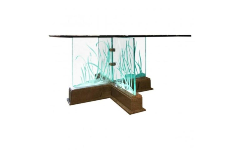 Modern midcentury etched glass lights up illuminated glass top dining table. Stone base. Design refers to architecture, furniture, and decorative items inspired by the