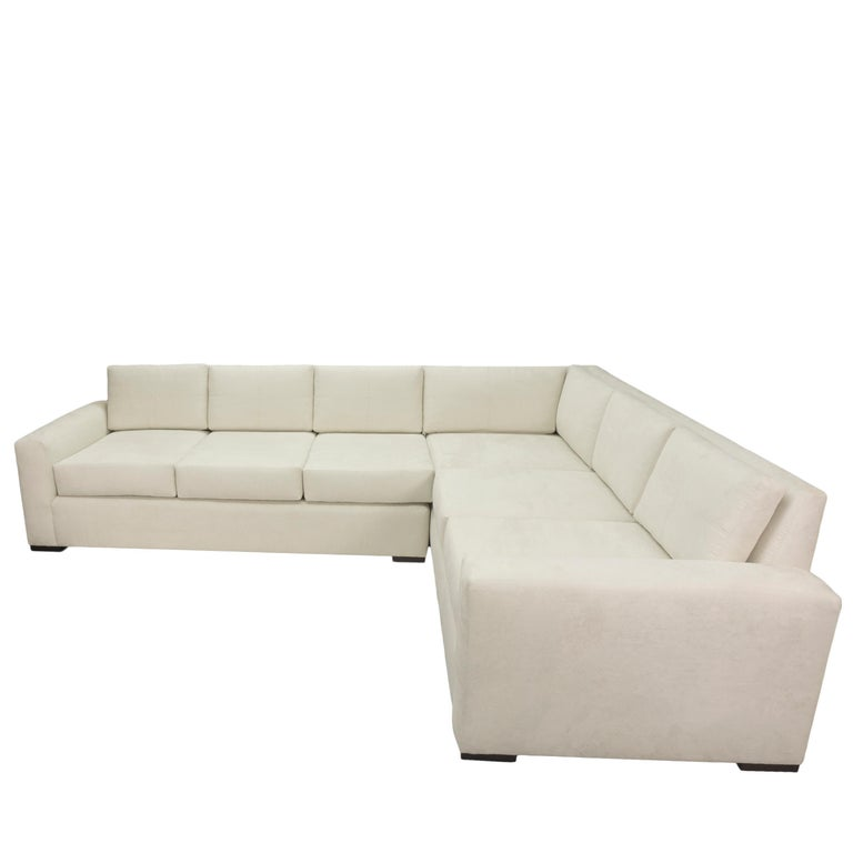 Our simple sectional sofa is a Classic and minimalistic design. This versatile sofa is shown put together as one large piece, but it can also divide into two sections that serve as matching love seats. The sofa features upholstered track arms and