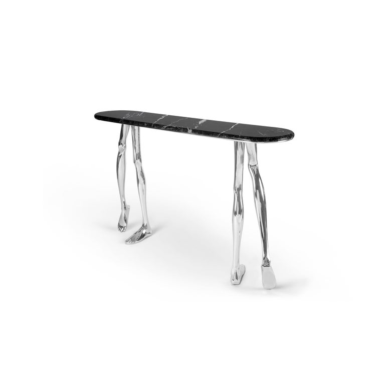 """1. Product description:  The """"Monroe"""" console table is made of polished nickel plated brass cast with a Black Markina marble complementing the set. After smelting, a process known for thousands of years widely used in brass and bronze sculptures and"""