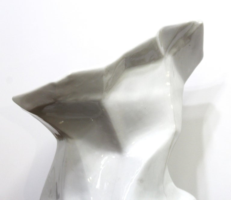 Modern Minimalist monumental ceramic floor vase in white, with angular body and everted mouth. In great vintage condition with age-appropriate wear.