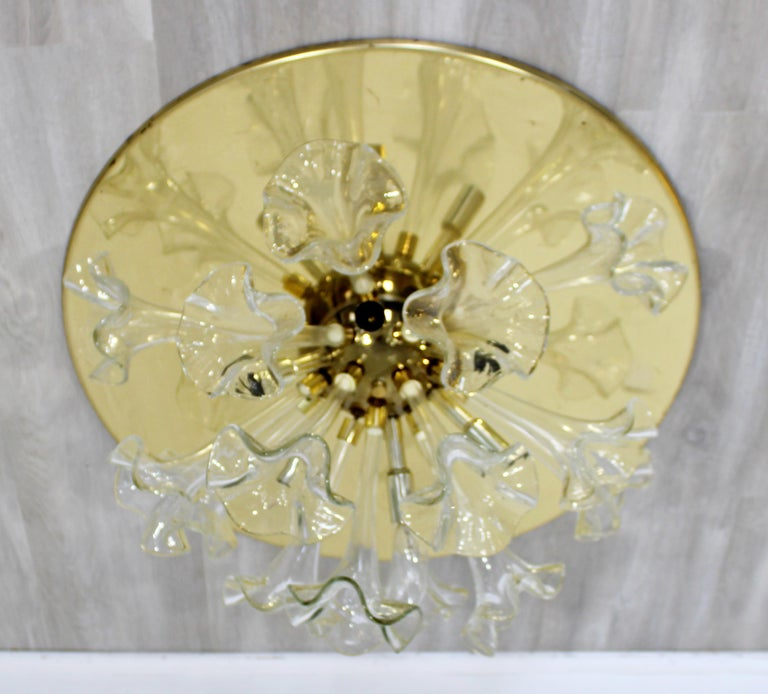 For your consideration is a magnificent, hand blown, Murano glass flowers and brass pendant chandelier, made in Italy, circa 1970s. In excellent vintage condition. The dimensions are 24
