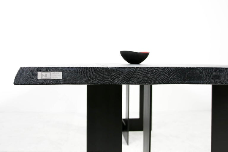 Beautiful contemporary Nathan Lindberg table, Mod. NL51 with a two-part heavyweight black matte finish steel base and a solid 45mm (1.8in.) brushed oak table top with beautiful structure, also heavyweight and black matte finish. This piece can be