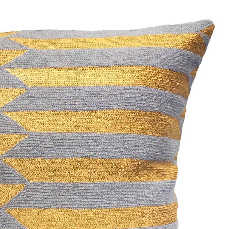 This pillow has been hand embroidered by artisans in Kashmir, India, using a traditional embroidery technique which is native to this region.