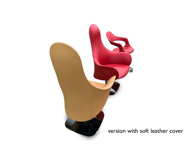 This is an Italian modern office chair, made in Italy, imported from Italy. It features a distinctive design, rarely seen in office designs. This modern swivel office armchair is a true beauty and is made of a rigid polyurethane shell structure with