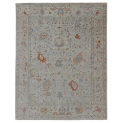 Modern Oushak Muted Rug in Coral and Light Blue