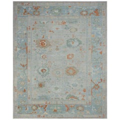 Modern Oushak Rug with Floral Designs in Green and Brown on Blue Gray Field