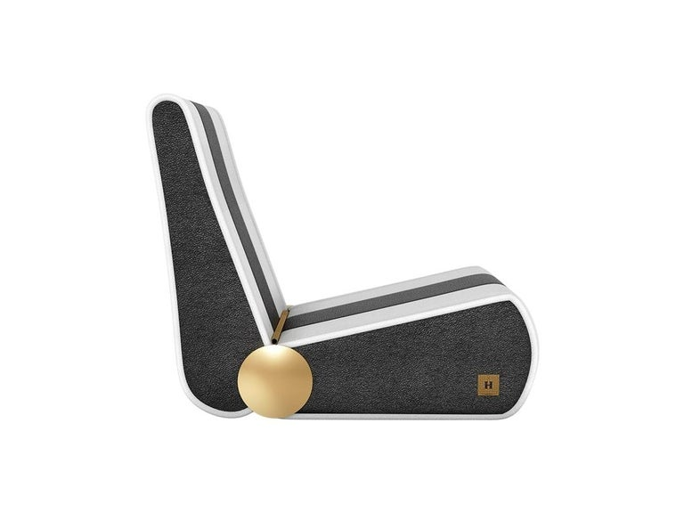 Modern Outdoor Folding Loung Chair Black & White with Gold Details | Marina chair Marina Lounge chair is born in the sea. The outdoor furniture piece is the perfect chair to contemplate a quiet dawn break or a golden sunset. As stylish as practical,