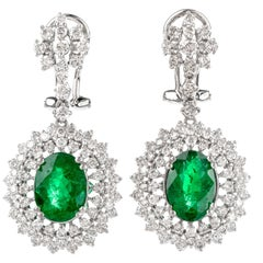 Modern Oval Emerald and Diamond 18 Karat Dangle Drop Earrings