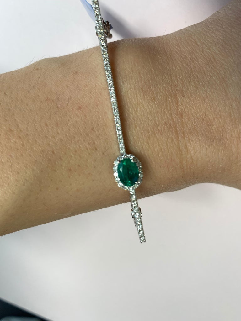 Modern Oval Emerald and Round Diamond Halo Square Bangle Bracelet 14K White Gold In New Condition For Sale In GREAT NECK, NY