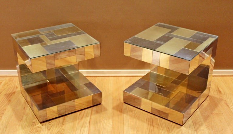 For your consideration is a wonderful pair of nightstands or side tables, made of patchwork brass and chrome and with glass tops, signed by Paul Evans for Directional, the Cityscape collection, circa 1970s. In good vintage condition. The dimensions