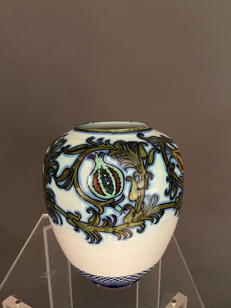 Italian artists Pietro Melandri and Paolo Zoli glazed majolica round shaped vase for 'La Faiance'.  Faenza Italy 1915 ca. This wonderful little masterpiece, depicting floral in shades of green to blue figures.  Signed on underside. This artwork is