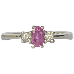 Modern Pink Sapphire and Diamond Platinum Three-Stone Ring