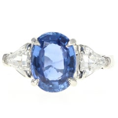 Modern Platinum 3.6 Carat Oval Cut No Heat Ceylon Sapphire and Diamond Ring