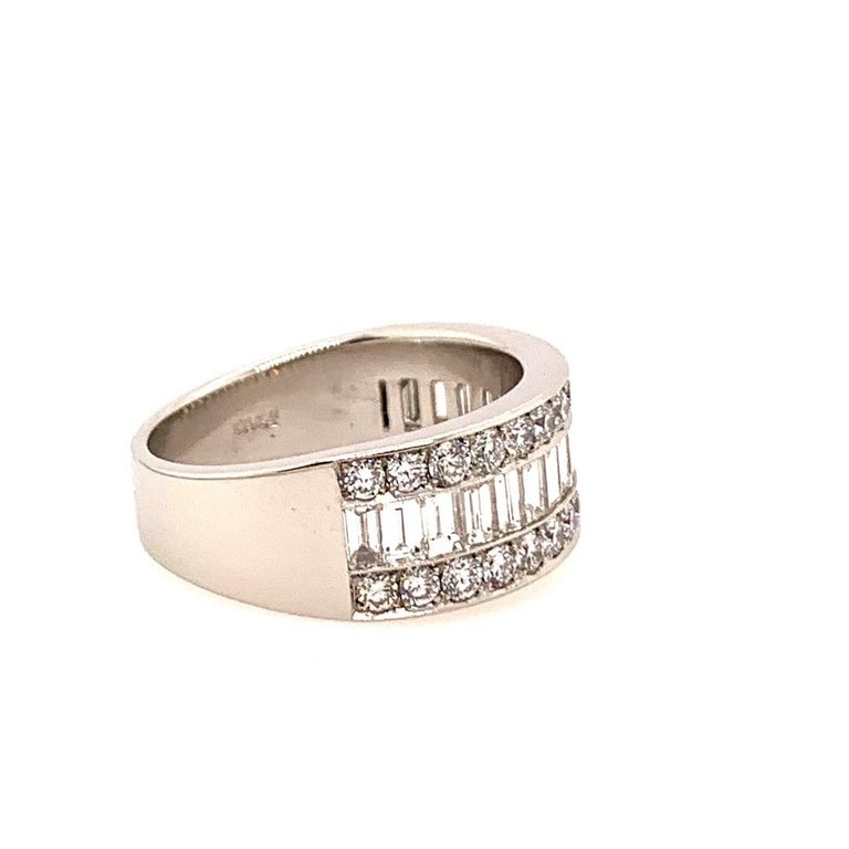 Modern Platinum 3 Carat Natural Diamond Band.  Set in this piece are 17 Natural F-G color Baguette Diamonds weighing 1.75 carats and measuring 3.5x2mm. In addition, there are 30 Natural Round Brilliant Diamonds weighing 1.25 carats.  The ring size