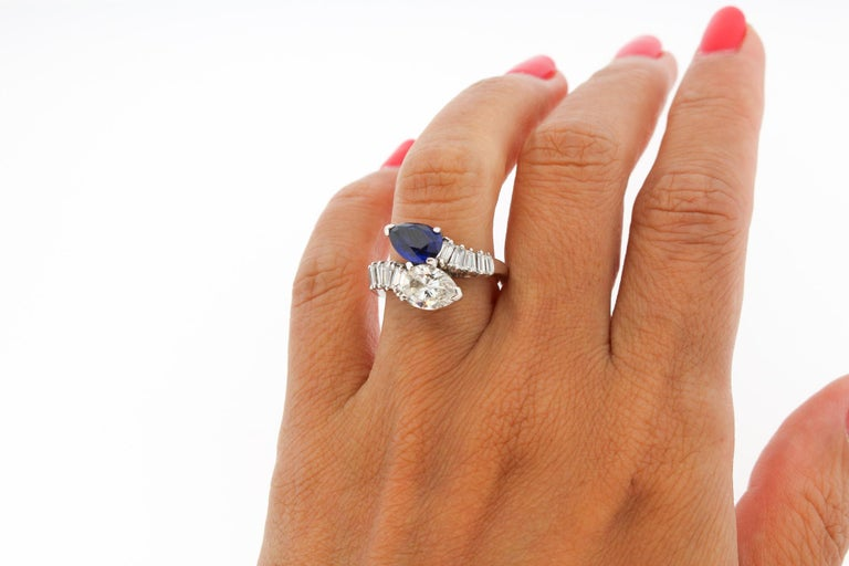 Modern Platinum Sapphire Diamond Bypass Ring In Good Condition For Sale In New York, NY