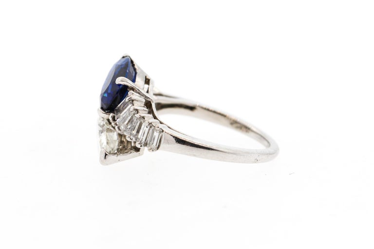 Women's Modern Platinum Sapphire Diamond Bypass Ring For Sale