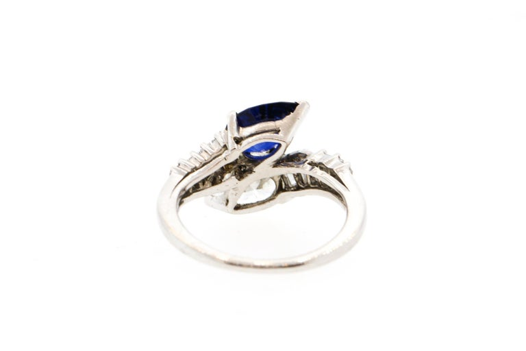 Modern Platinum Sapphire Diamond Bypass Ring For Sale 1