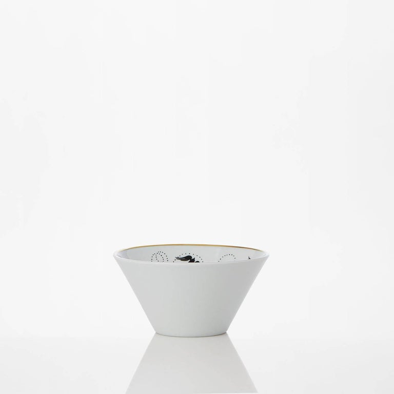 """Safia Ouares, illustrator, interpreted her vison of nature on two cups. The second one: """"Primavera"""" (=spring), is an ode to the spring of nature.  Extra-fine porcelain. Extra-white.  White and black serigraphy.Gold painted by the hand."""