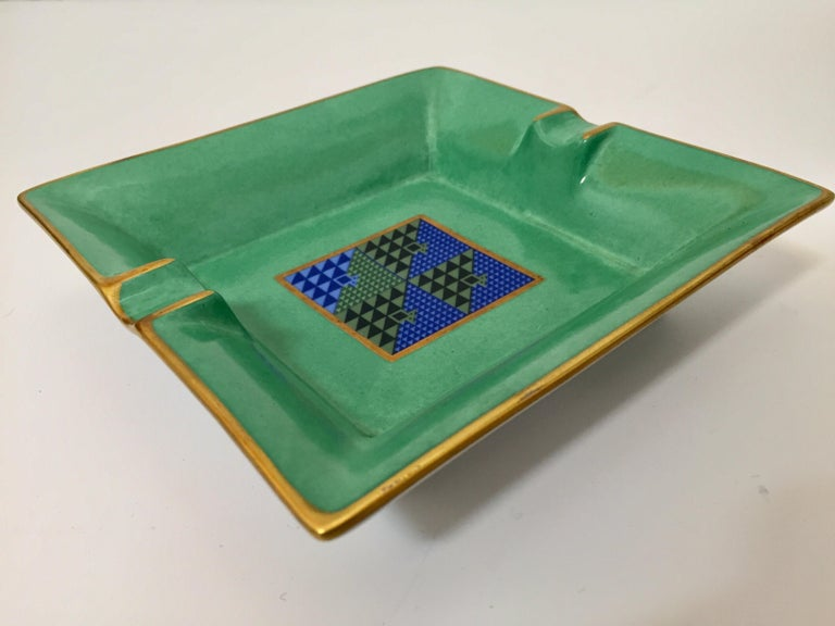 Modern porcelain square green and gold ashtray with a modernist abstract blue design in the middle. Use it as an ashtray, vide poche or for decorative bowl. Stamped Limoges, Porcelain, France. Bauhaus style with Post Modern design.