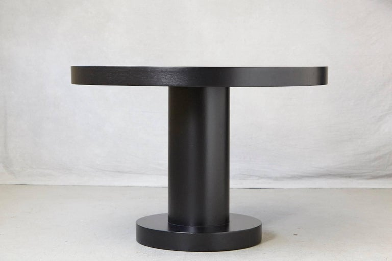 Modern, timeless oak center table in a new black satin finish. A pure and minimalistic appearance, a very solid quality construction. The table dates back to the 1960's has been professionally lacquered and is in excellent condition.